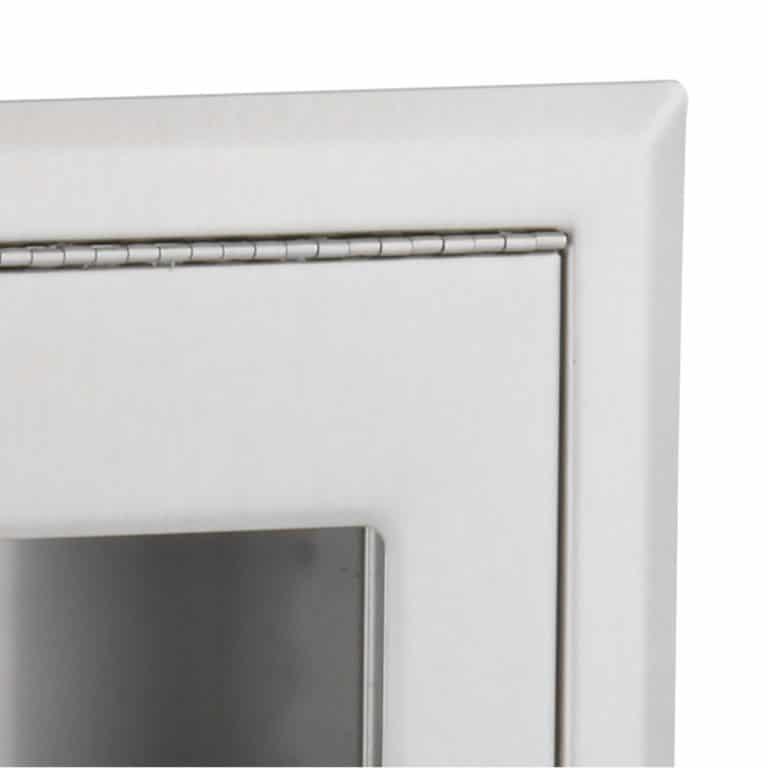Bobrick B-301 ClassicSeries recessed seat cover dispenser corner detail view.