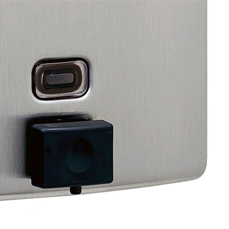 Detail view of Bobrick B-4112 ConturaSeries surface mount soap dispenser.