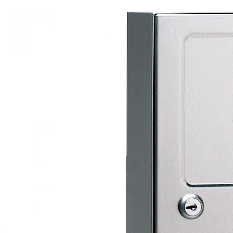 Lock detail on Bobrick B-254 surface mounted sanitary napkin disposal.