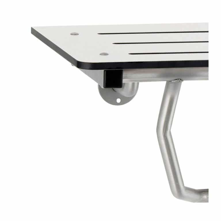Detail of Bobrick B-5181 reversible solid phenolic folding shower seat.