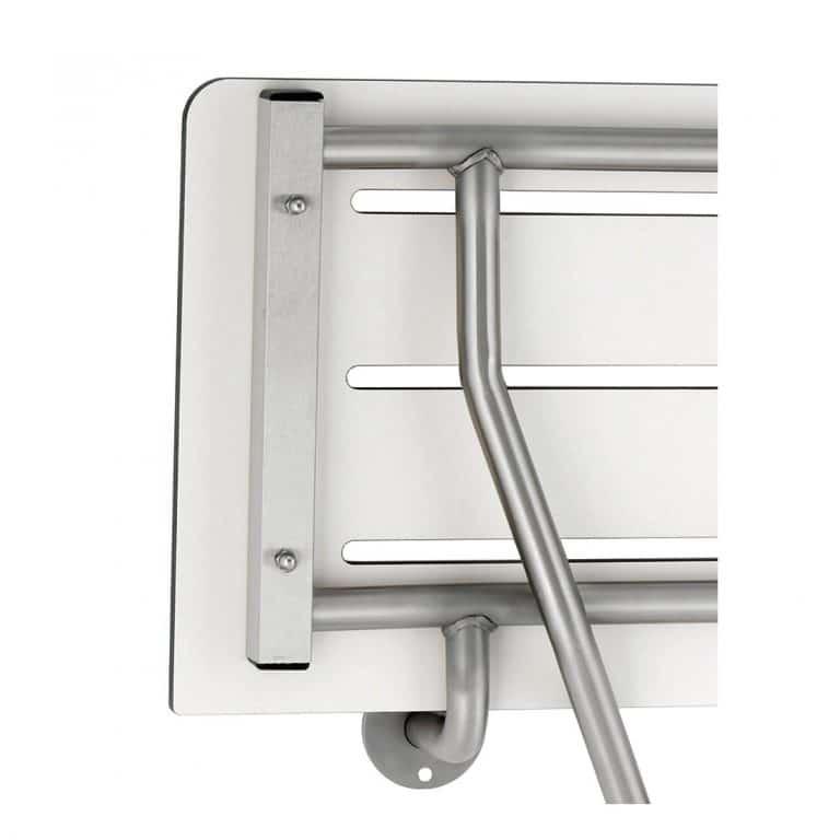 Underside corner detail of Bobrick B-5181 phenolic folding shower seat.