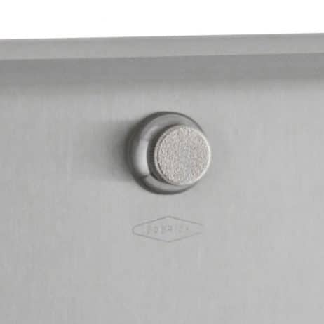 Detail of knob latch on Bobrick Surface Mount Paper Towel Dispenser B-2621