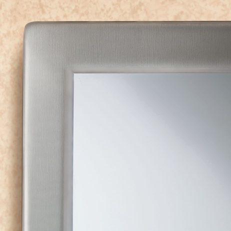 Bobrick Glass Mirror Stainless Steel Angle Frame B-290 against beige.