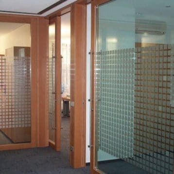 The Hawa Super sliding hardware system for wood doors installed.