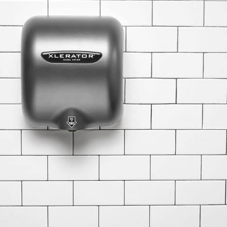 Graphite Textured Painted Excel XLERATOR hand dryer against white tile.