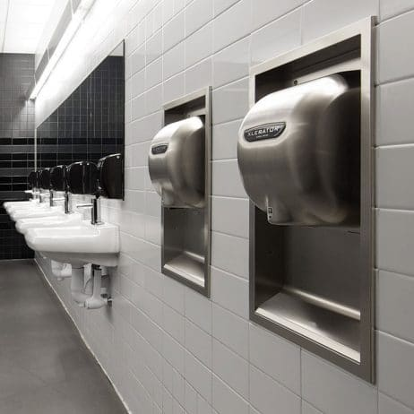 Brushed Stainless Steel XLERATOR hand dryer pictured in contemporary bathroom.