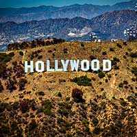 Photograph of famous large white letters spelling Hollywood on mountainside.
