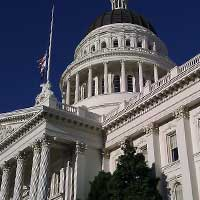 Photograph of large white Sacramento, California capitol building, classical architecture.