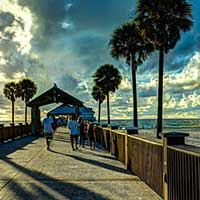Photograph of an Orlando, Florida pier with trees and clouds.