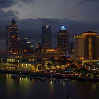 Photograph of Tampa, Florida city skyline at night with lights.