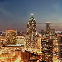 Photograph of Atlanta, Georgia city skyline at night with lights.