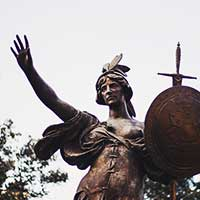 Photograph of dark metal sculpture of female warrior in Detroit.