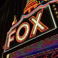 "Photograph of neon sign reading ""Fox"" outside Detroit's Fox Theater."