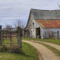 Photograph of old barn and dirt road in Ohio countryside.