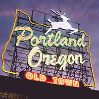 Photograph of sign reading Portland Oregon with deer, state outline.