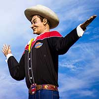 Photograph of cowboy statue near entrance to Dallas, Texas fair.