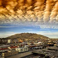 Digitally enhanced photograph of clouds over El Paso, Texas cityscape.