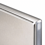 Photograph of corner of panel of stainless steel toilet partition.