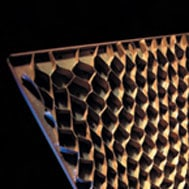 Photograph of honeycomb within steel partition panel.