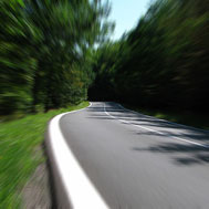 Photo of a road with streaking showing speed.