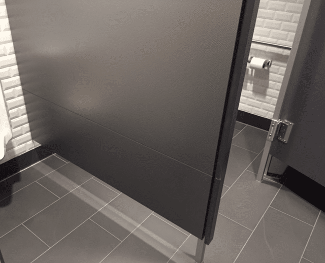 Rendering of solid plastic bathroom partition using stacked panels.