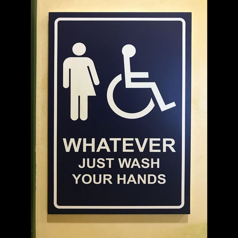 "Photo of ""Whatever Just Wash Your Hands"" sign."