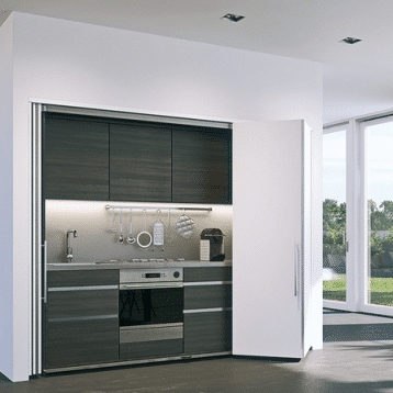 Rendering of a Hawa Concepta Folding/Sliding Door system concealing a kitchenette.