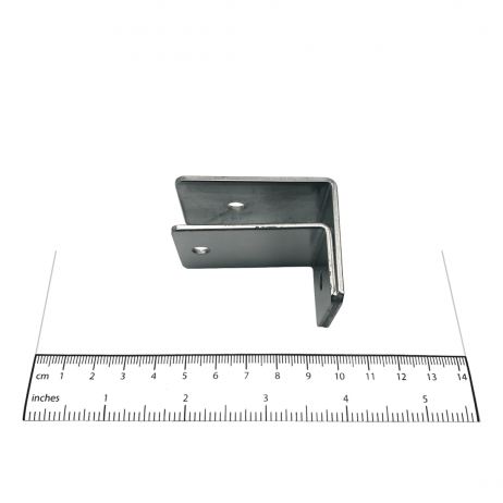 Photograph of Bobrick F-Bracket Internal Panel-to-Wall - 1000975 shown with ruler for scale.