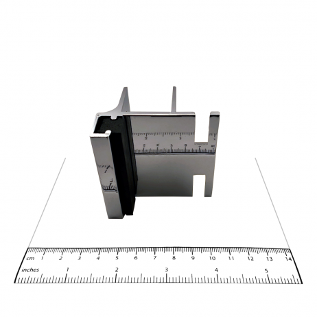 Photograph of keeper from Bobrick In-Swing Door Hardware Kit - 1002038, with ruler.