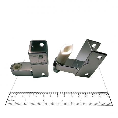 Photograph of hinge components from Bobrick In-Swing Door Hardware Kit - 1002038, with ruler.