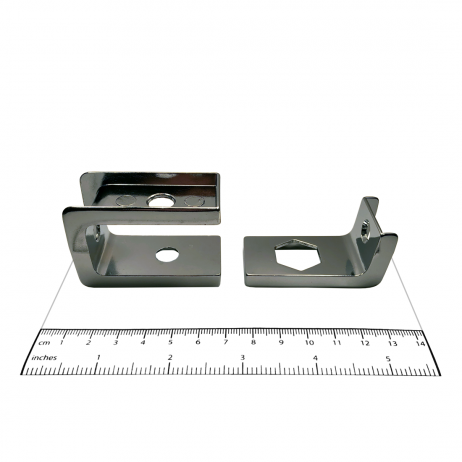Photograph of notch flanges from Bobrick In-Swing Door Hardware Kit - 1002038, with ruler.