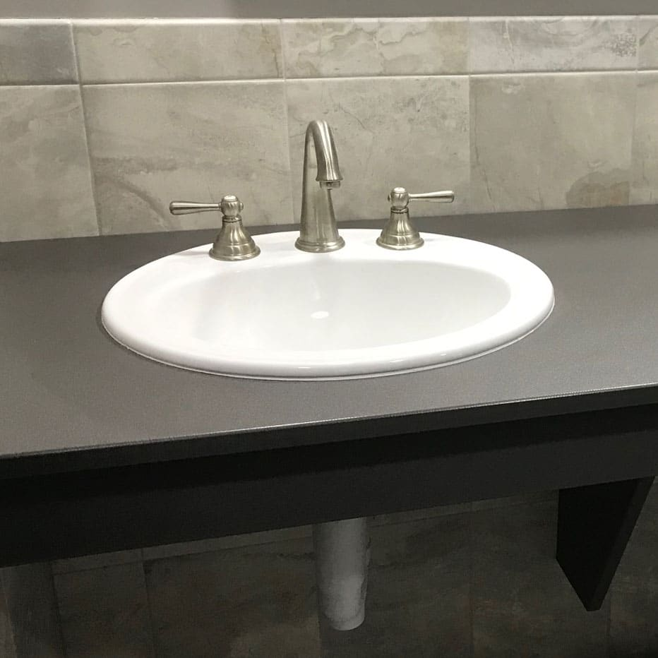 Photograph of a sink bowl and three-piece faucet installed in a Scranton Products HDPE vanity top.