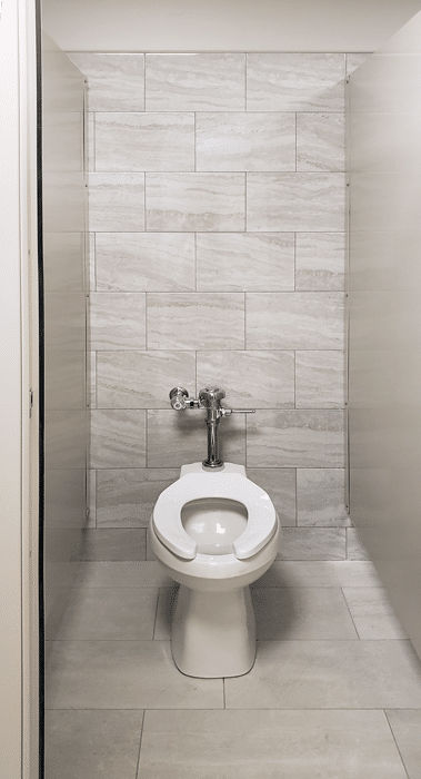 Photograph of an individual Elite Plus toilet stall, showing continuous brackets and low mounting height.